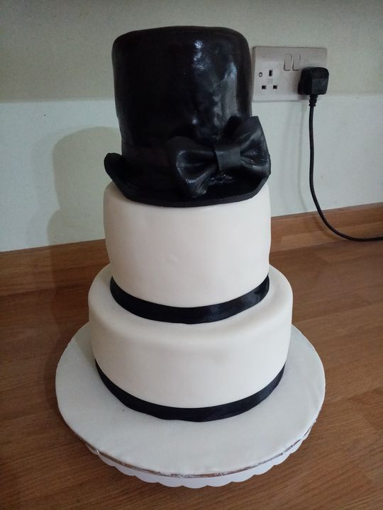 Client added her own cake toppers. 3 tiers of vanilla sponge. X
