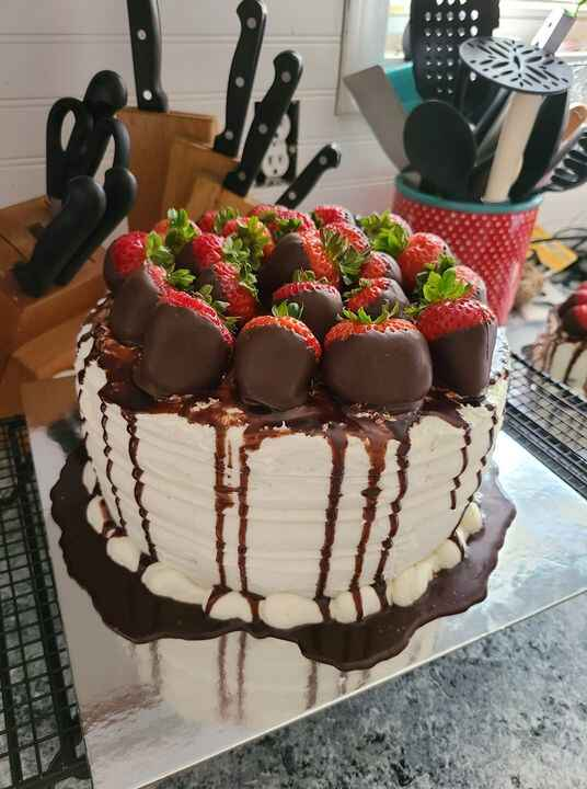 3 layer White cake with vanilla butter cream, chocolate Ganache, and topped with chocolate covered strawberries. So deli...
