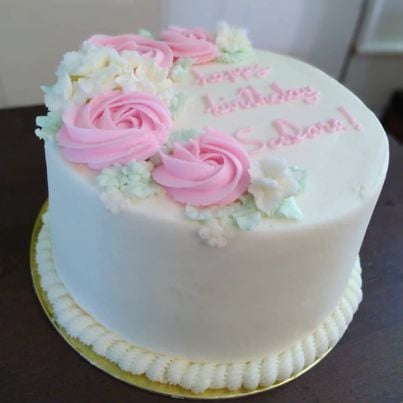 There is something about the simplicity of a white cake that brings out the sweetest in occasions and the loveliest in c...