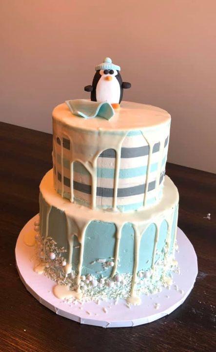 Fun penguin themed baby shower cake!